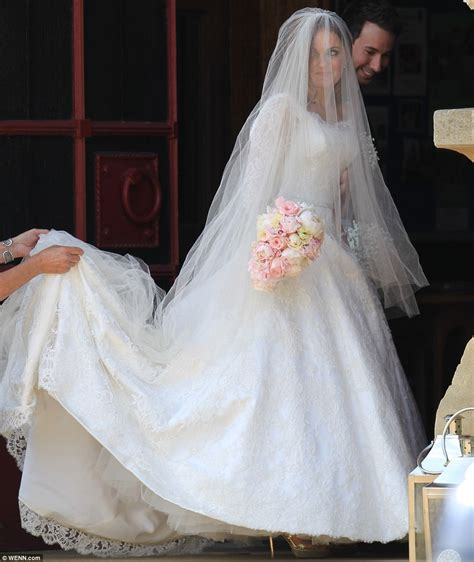 Geri Halliwell with daughter Bluebell as she marries F1's ...