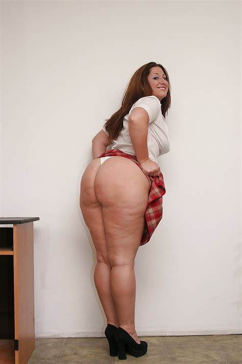 Fatty Brunette In Checkered Miniskirt Revealing Her Saggy