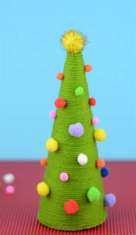 craft activities images on the occasion of christmas pom pom diy tree favecrafts