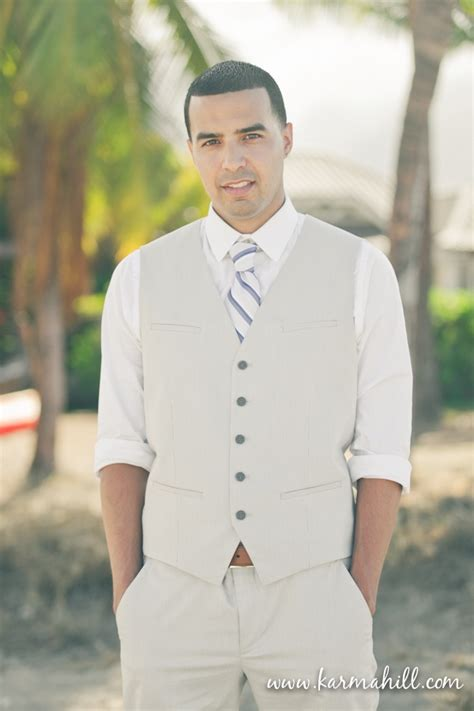 Picture Of A Tan Suit With A Vest A Striped Tie A Shirt