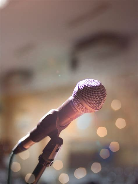 person holding microphone  stock photo