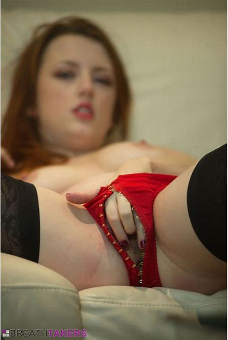 Jenny Smith in her red lingerie and black stockings