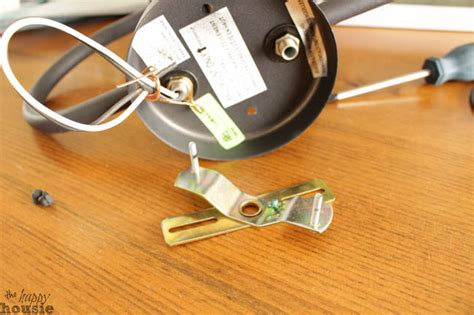 how to turn a hard wired light fixture into a plug in