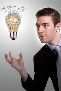 Concentrated Businessman Looking At A Light Bulb With