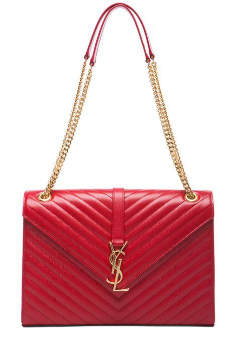 saint laurent large monogramme chain bag  red lipstick