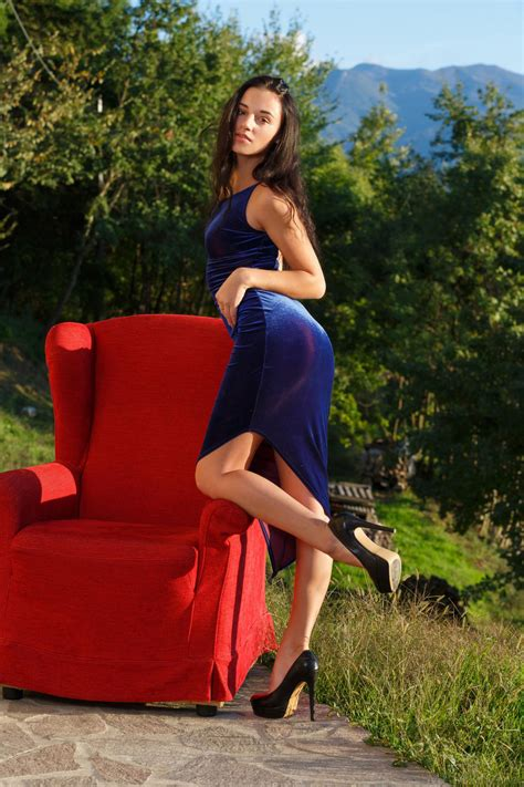 Dress Wearing Luxurious Brunette Shows Her Pussy On A Red Chair