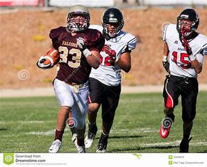Football Player Running With The Ball During A Game ...