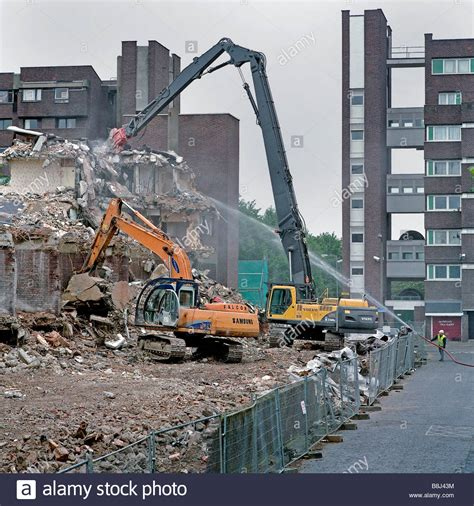 Examples include turning on the gas or water supply valves to fixtures and appliances, or activating electrical breakers or fuses. Machine-mounted breaker destroying reinforced concrete walls of Stock Photo, Royalty Free Image ...