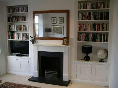 Built In Cupboards Next To Fireplace by Alcove Shelves Shelves Shelves Lounges