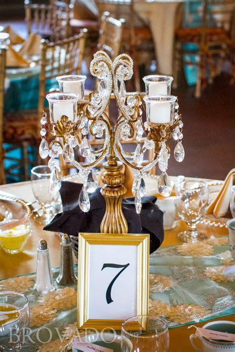 gold candelabra centerpiece  wedding reception