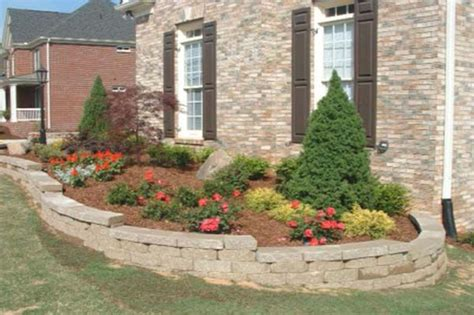 planter ideas for front of house red flowers and green trees on the gray planter box in front of brown brick house of wonderful