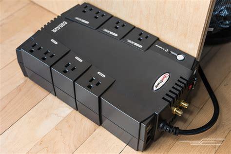 power supply uninterruptible surge protector ups desk under cyberpower wirecutter sits overgrown