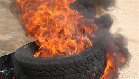 Burning Smoking Tire, Fire Destroys Tire Stock Footage