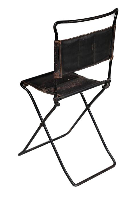 children s antique leather and cast iron folding chair for