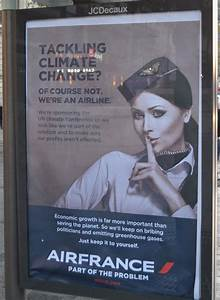 Paris is covered in fake ads mocking climate talk sponsors for Brandalism fake ads paris