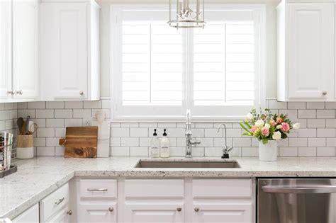 white granite kitchen countertops  white subway tile