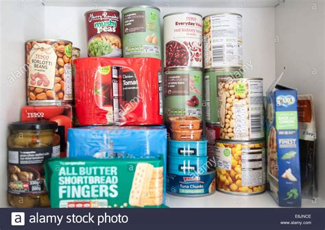 Cupboard Food by Tinned Food Produce In A Kitchen Cupboard Uk Stock Photo