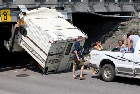 truck camper hits railroad overpass local