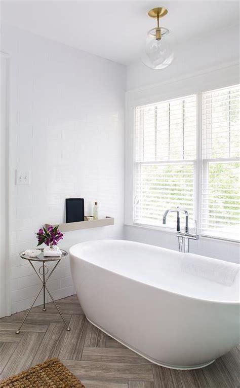 white bathroom  gray herringbone tile floor contemporary bathroom