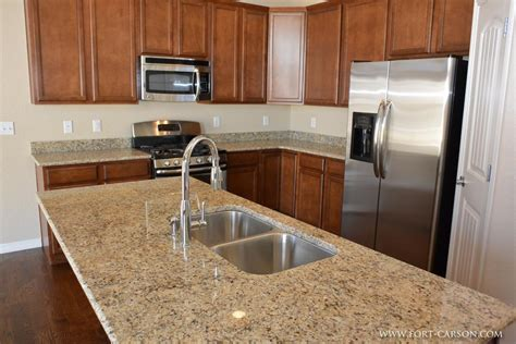 island sinks kitchen a closeup view of the granite slab countertop and the undermount stainless steel sink in the