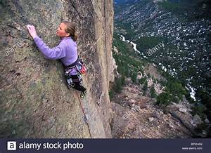 Woman rock climbing in Rocky Mountain National Park ...