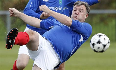 ed balls labours   football pitch tackling