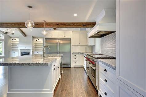 white hex tile kitchen backsplash  black grout