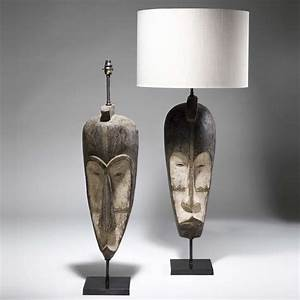 Pair of large brown african tribal mask lamps on bronze