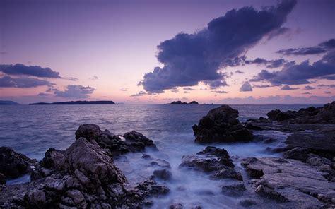 1920x1200 Ocean Pretty Rocks Purple Sky desktop PC and Mac