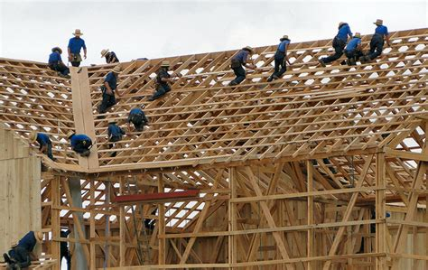 Amish Barn Raising amish rebuild with alacrity peaceful societies