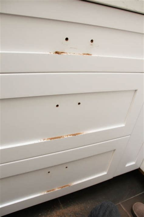 How to Install Cabinet Knobs with a Template {a trick for