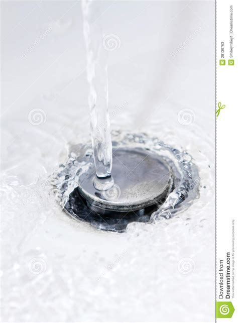 Water Running Down A Bathroom Sink Plug Hole Stock Image