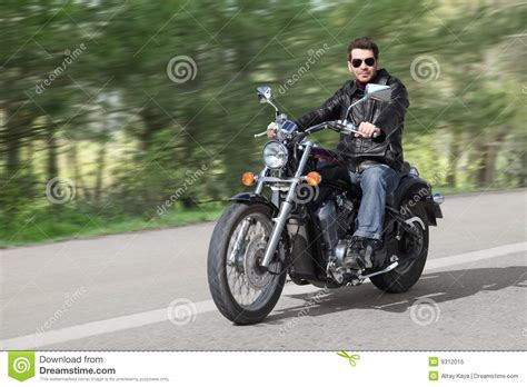 Young Rider Driving Motorcycle Stock Image