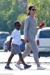 Sandra Bullock gives her son Louis an affectionate pat ...