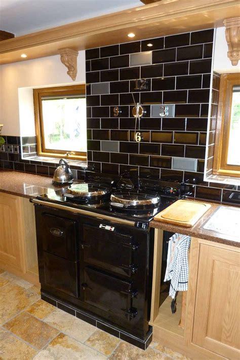 kitchen with black floor tiles meble kuchenne premium aranżacja kuchni aga kuchnie z 8738