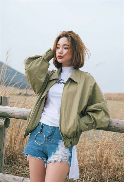 white top short jeans  olive jacket ladystyle