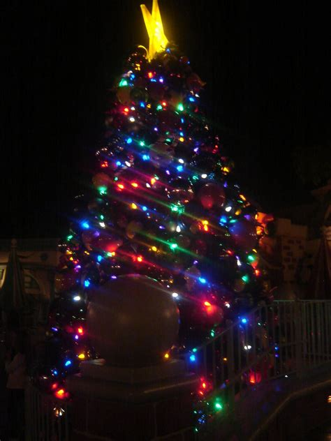 christmas tree with blue green red lights by espioartwork