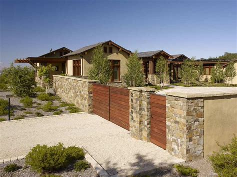 Stone Fence With Wood And Stucco Accents