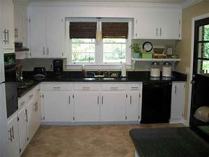 dark brown kitchen cabinets with black appliances With white and brown kitchen designs