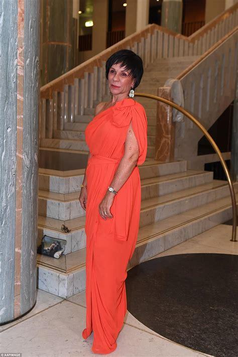 orange slipper chair julie bishop slammed for wearing 32 000 gown