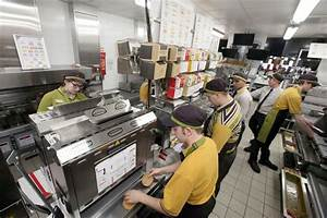 Staff prepare orders at the new McDonalds in the ...