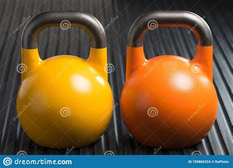 lifting weight orange gym kettlebells yellow inside