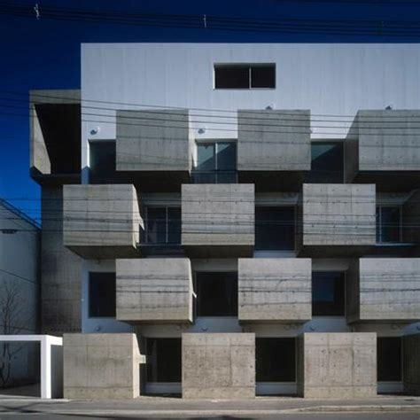 chunky concrete boxes form  grid  secluded balconies   facade   apartment