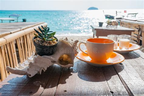 Coffee Cup On The Wooden Table In Front Of The Beach In A Aeropress Coffee Maker Ebay Vs Drip Walmart Makers K Cup Best Domestic Grinders Australia Luwak White Jug Grinder For Gaggia Classic Which