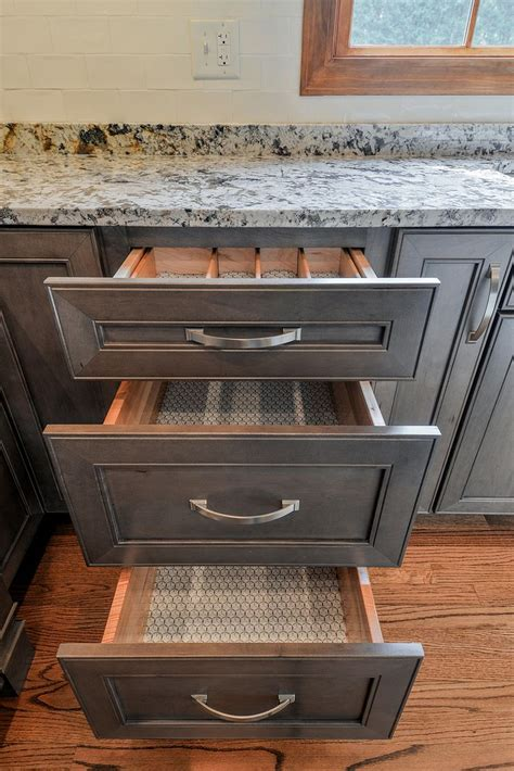 wellborn cabinet  premier series sonoma door style  maple wood stained  drift