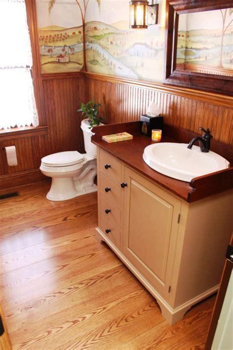 vintage inspired bath  red oak wood floor  narrow red oak beadboard wainscot