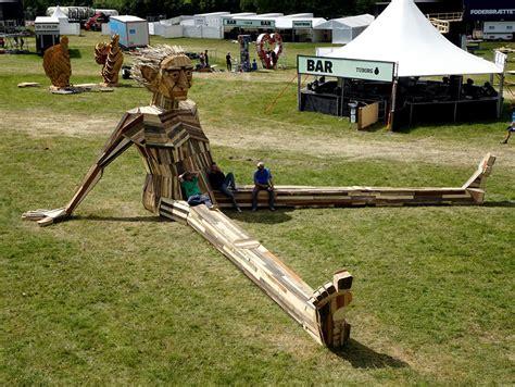create giant sculptures  scrap wood bored panda