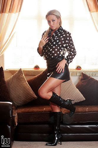 Natalia Forrest in leather skirt, boots and sheer blouse