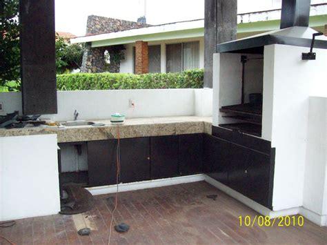 foto asador y barra terraza de construcciones y