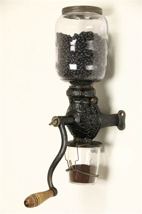 sold arcade crystal  antique wall coffee grinder